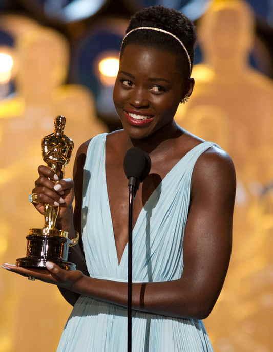 Lupita Nyong'o with Oscar