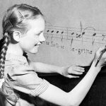 Julie Andrews at play in family music room in 1947
